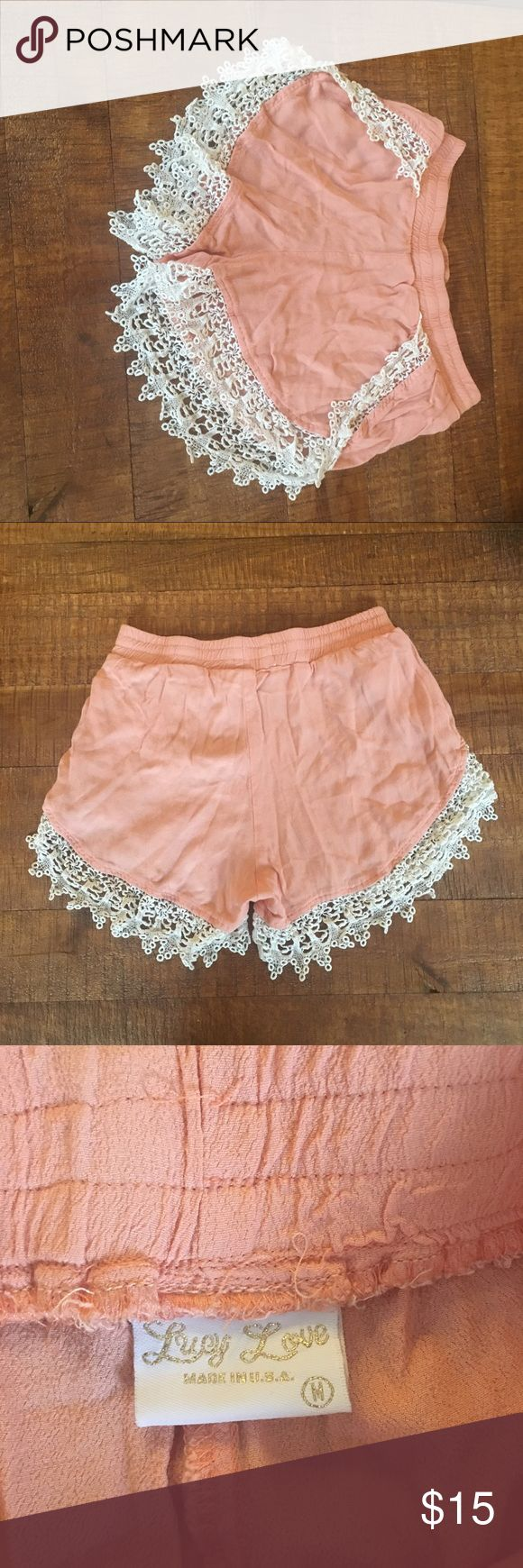 Peach shorts with crochet trim Peach shorts with crochet trim, says size medium but fits like a small Shorts