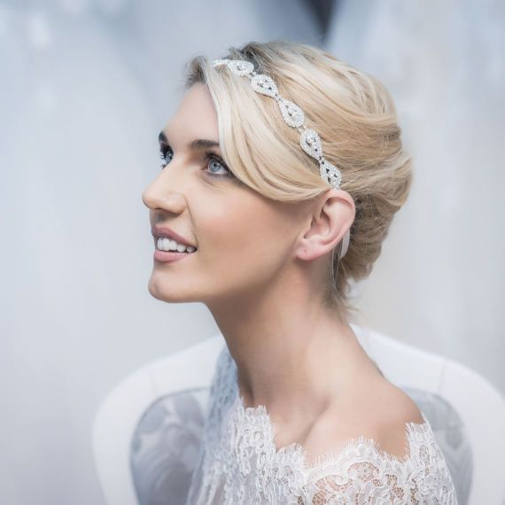 A sparkling hair piece made of cut crystals with satin