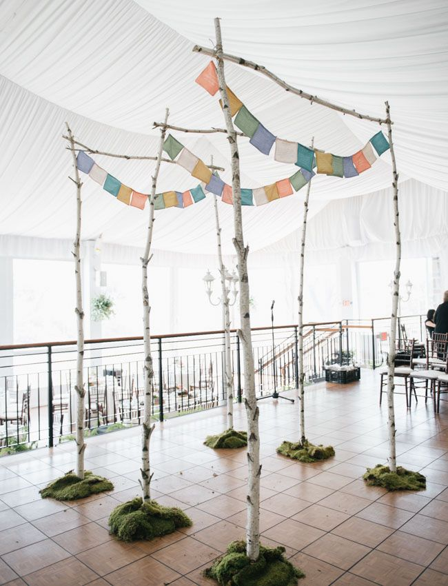 love this branched arbor with prayer flags, so sweet!