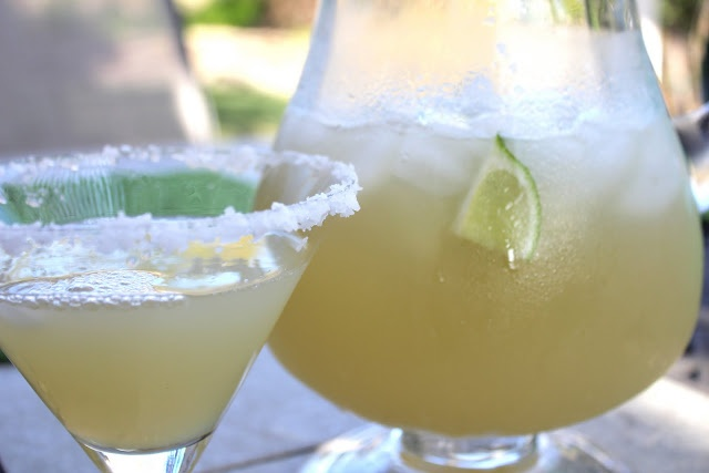 Beer Margaritas  1 ( 12 fluid ounce) can frozen limeade concentrate  12 fluid ounces tequila  12 fluid ounces of water  12 fluid ounces of corona  1 lime, cut into wedges  Ice and salt for rim