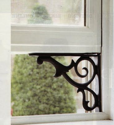 Shelf brackets to hold up a window. Smart and cute! by adeline