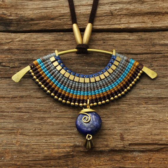 Woven tribal necklace with waxed cotton cord, lapis lazuli set into brass dangle.  By cafeandshiraz at Etsy, $86.00