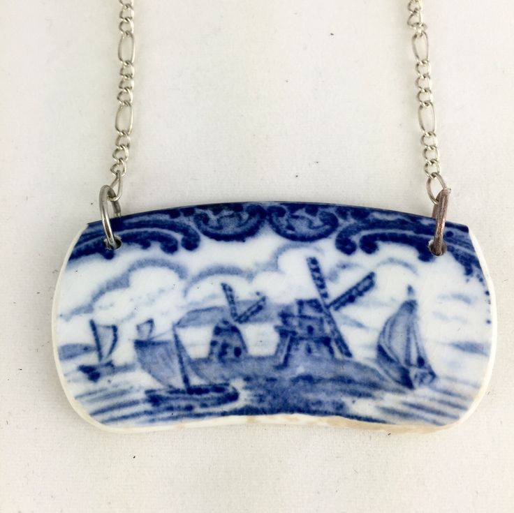 Sail boats and windmills this cute necklace came from a vintage Wedgwood plate. Hand cut and sanded until smooth then edges are sealed. There is some discoloring on the bottom from were there was crac