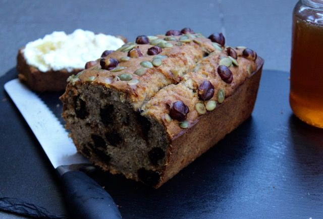 Banana Hazelnut Bread is a one bowl affair and cooks perfectly with gluten free flour. Enjoy it toasted with ricotta and honey. www.cookfasteatslow.com