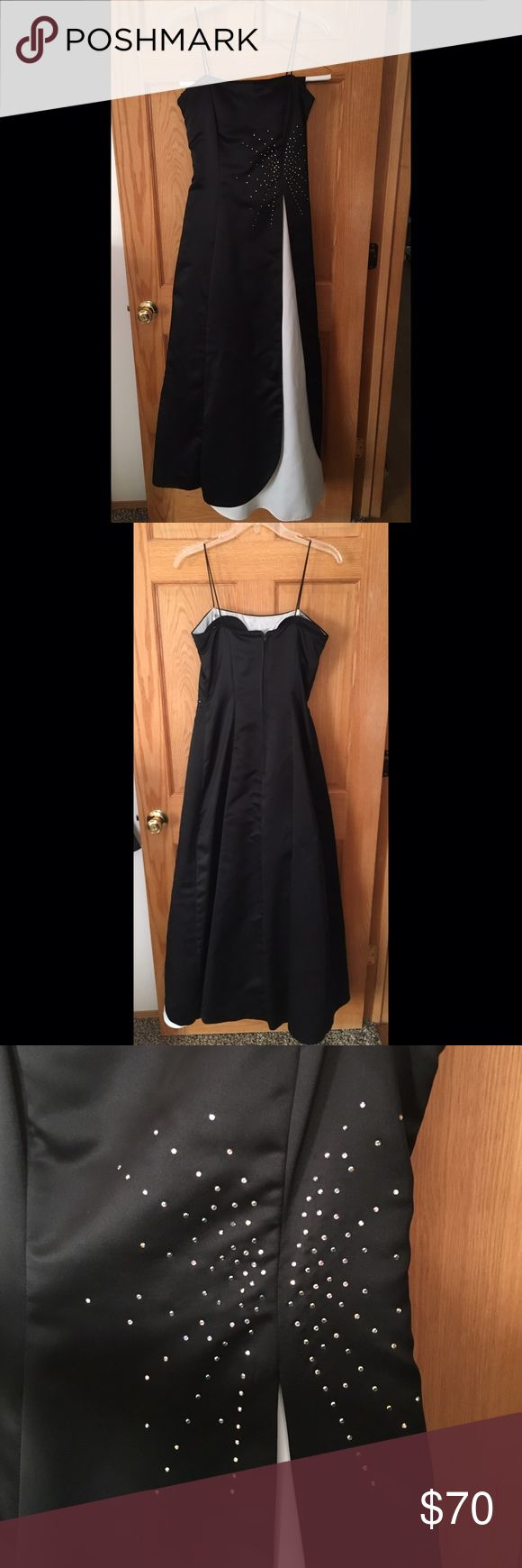 Black and white formal dress with rhinestones Spaghetti strap, black and white formal dress with rhinestones. Great condition, worn once. Some staining to the white fabric.(shown in photos) Built in slip and a little poofyness from tulle fabric. Comes with shawl, never used. Size 5-6 Laura Ryner Dresses Prom