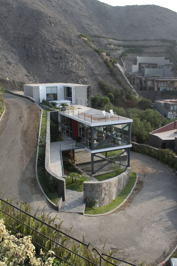 A House Built On The Side Of A Steep Hill Architecture