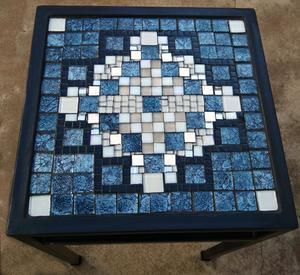 Geometric pattern glass mosaic on small square wrought iron table. R1000.00
