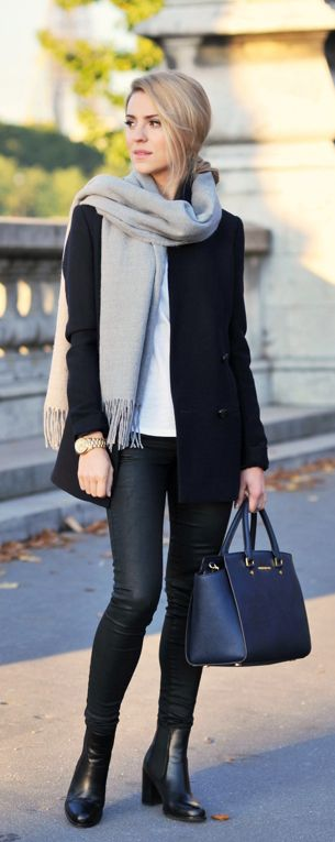 Street Style September: Katarzyna Tusk is wearing a grey scarf from Cubus, black coat from Massimo Dutti, black trousers from Topshop, bag from Michael Kors and boots from Kazar