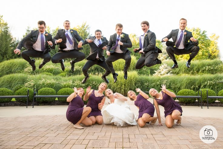Groomsmen jumping over bridesmaids