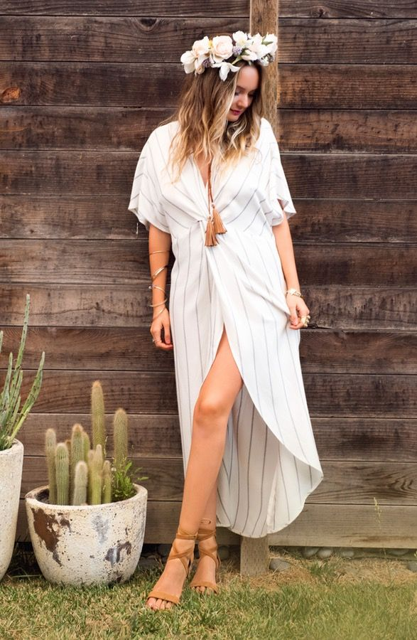 Festival gown. This drapey maxi dress with dramatic slit is both combines classic elegance with contemporary boho vibes