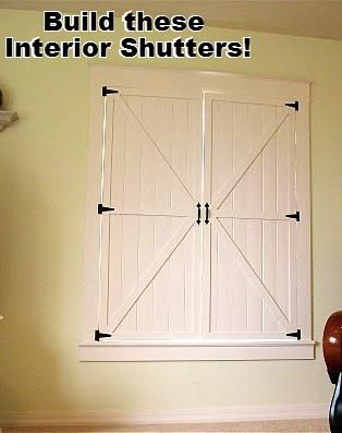 Make your own indoor shutters.  I think it would be nice to split them with 2 smaller upper shutters and 2 larger lower shutters.  That way you can let the light in without interferring with your tv or blinding you in the room.