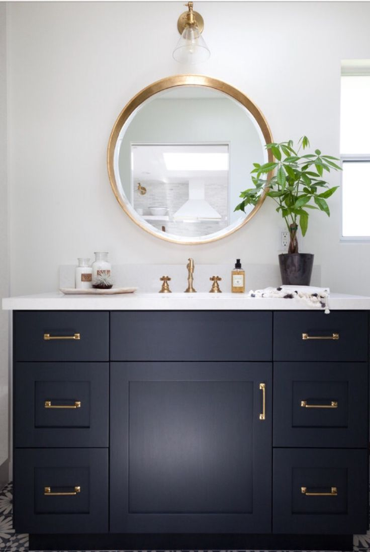 Bathroom done in F/B Hague Blue cabinets with gold pulls