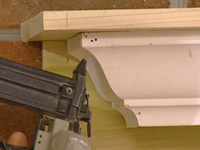Use crown molding to create a mantel shelf.....wonder if this would be cheaper?