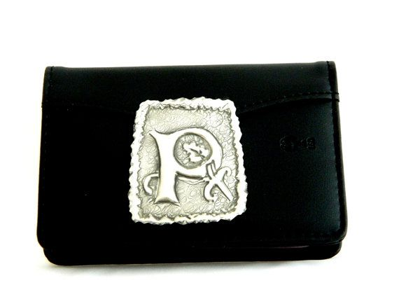 "A PU leather credit card holder with 12 plastic insets and an inner back pocket. Personalise with this pewter repousse initial for a beautiful gift for dad on fathers day.    The wallet measures 12cm (4 3/4"") across and 7.5cm (3"") high.    The initial measures approx 5 1/2cm (2 1/4 "") x 4cm (1 1/2"")."