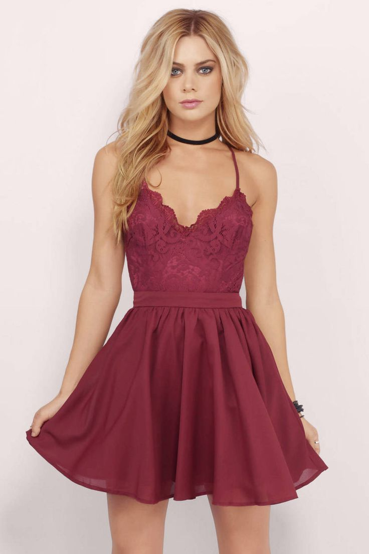 The Mila Dress is part romance, part sass. This skater dress features a lacy bodice and criss-cross back straps. Own the night with some strappy heels