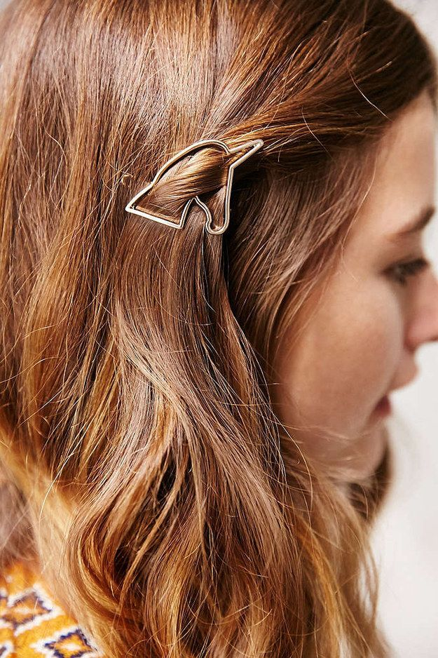 A delicate unicorn pin to gently push aside your side bangs with.
