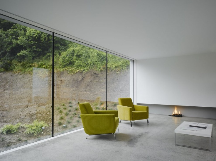 Love the fireplace!  Dwelling at Maytree  Wicklow, Ireland  A project by: ODOS