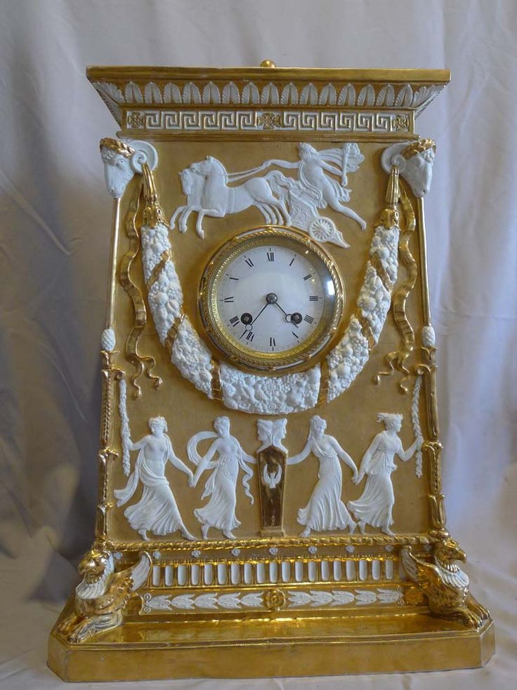 Late 19th/early 20th Century Samson Bisque porcelain Mantel Clock - in neo-classical style, parcel gilded with gadrooned bell top above acanthus leaf and Greek key frieze, raised upon a plinth base with griffin supports. - Gavin Douglas Antiques