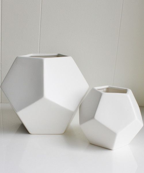 """- White Faceted Vases - a stunning ceramic set, finished in a matte white glaze - available in two sizes - small: 4.5"""" wide x 4"""" high $18.00 - large: 7"""" wide x 6"""" high $38.00"""