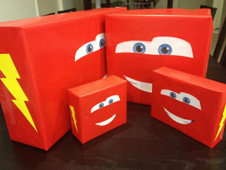 Disney Cars Party - Begun wrapping presents to match the theme. Can't wait to see his face. Just red wrapping paper, eyes and mouth printed and cut out and yellow cardboard lightening bolts.