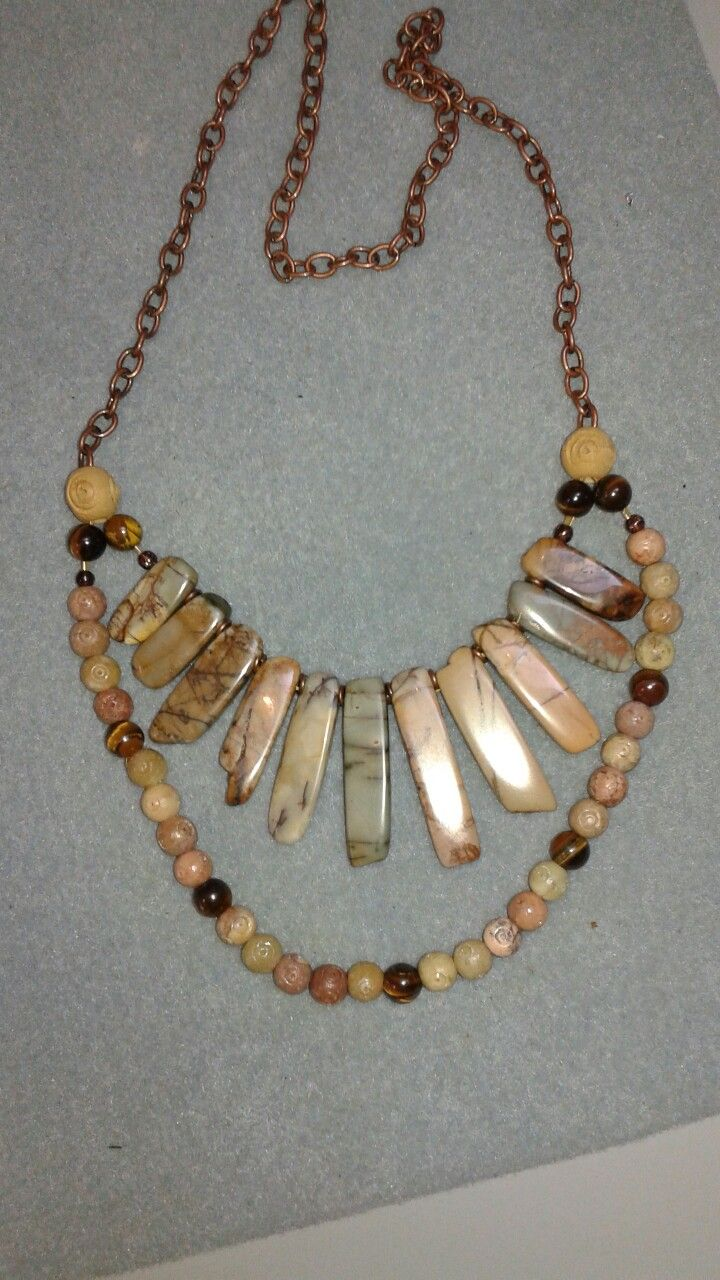 Variegated tan flat stones, soapstone round beads with 9 tiger eye beads attach to a bronze chain for a 2 strand necklace