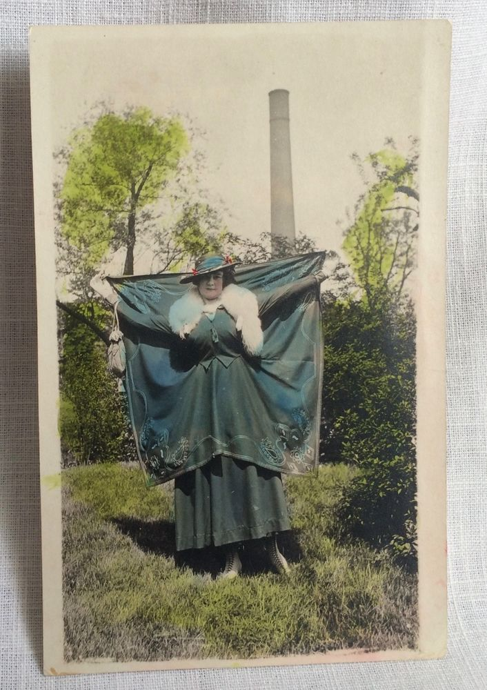Hand Tinted Real Photo Postcard Woman in Unusual Dress REXO Stamp Box Unposted