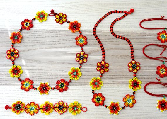 Color: Red, yellow, orange  Size: 23.5 x 1.25  58.5 cm x 3.2 cm  Every flower in this necklace is different, and was carefully handmade with czech glass seed beads, between each flowers there is one red and black bean as spacer and beaded bead is used for closure.  Note this is a re-stocked item, you will receive the exact necklace pictured in image 2, 3, 4 y 5 ☞About my work I like to call it ethnic with contemporary twist For my pieces I initially was inspired by the work of Mexican and…