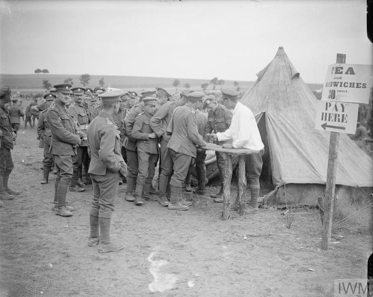 """WWI, 18 July 1917; """"Tea and Sandwiches 30 cent"""" -Soldiers buying tea tickets at the 33rd Division Horse Show at Cavillon. ©IWM Q 5696"""