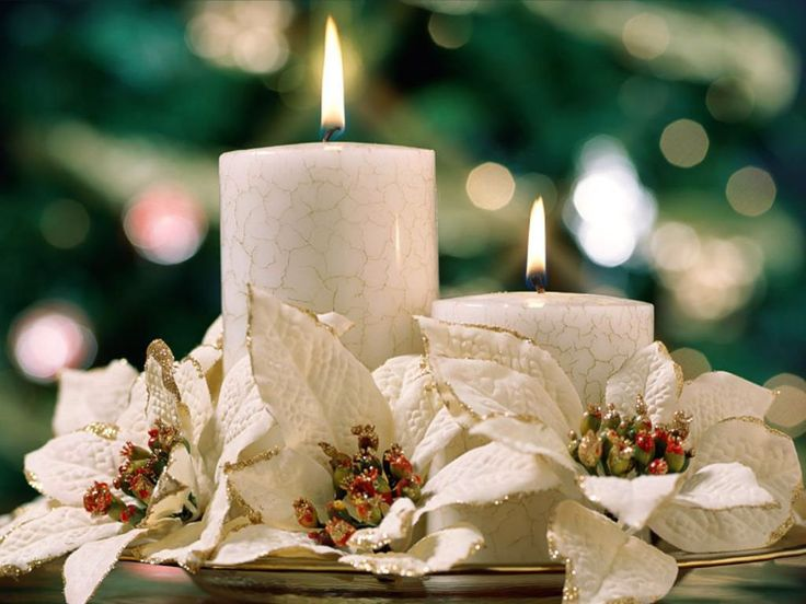 White candles and poinsettias -- table arrangement for christmas