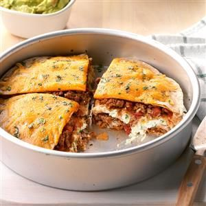 Tortilla Pie Recipe -My husband and I especially like this delicious layered entree because it's lighter tasting than some of the traditional lasagnas made with pasta. Even our two young daughters enjoy the pleasantly mild flavor. —Lisa King, Caledonia, Michigan