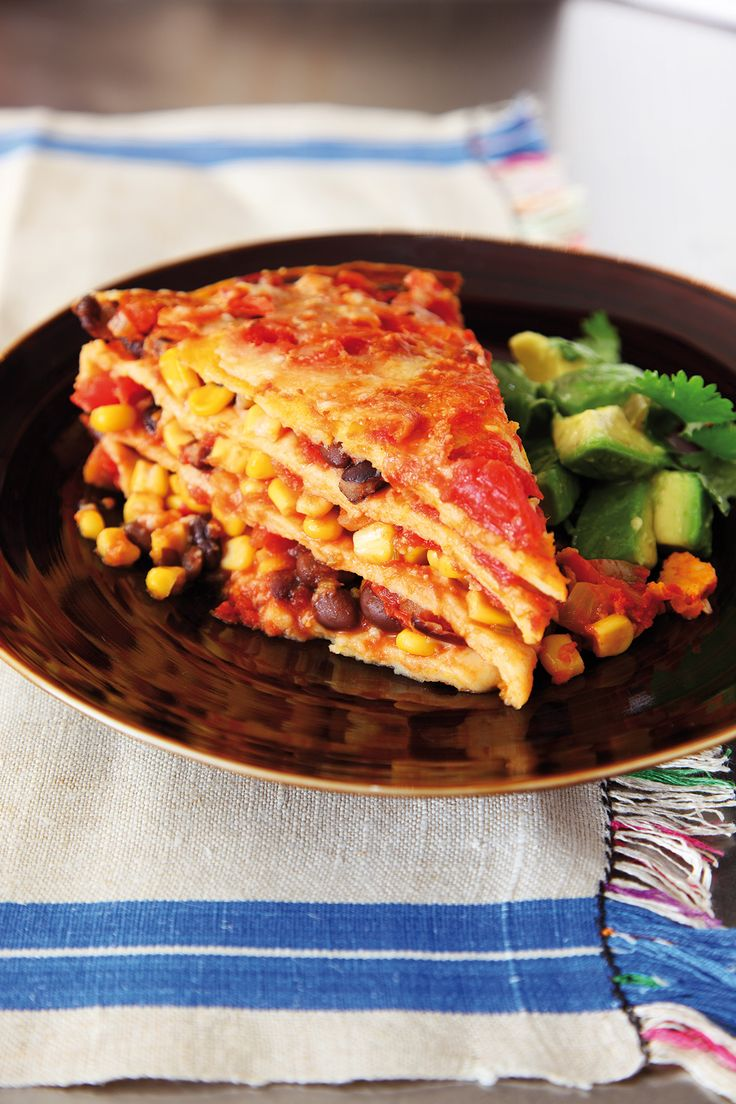 This is a shorthand for Mexican-inspired ingredients piled up in lasagne-like fashion. In place of pasta layers, there are soft tortillas and in between them a riotous assembly of tomato, red pepper, onion, chilli, corn and cheese. You can see from the pi
