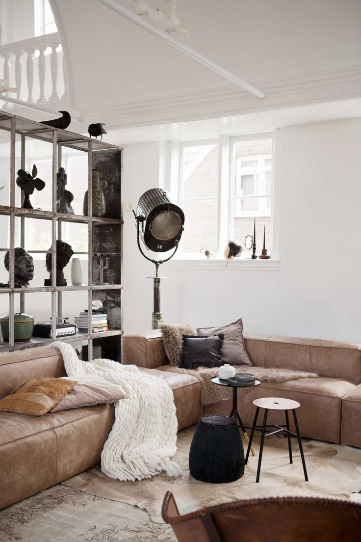 Cool industrial living room with leather sofa