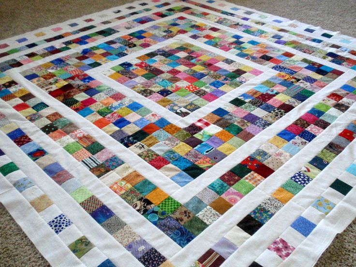 Scraps but I wouldn't make the outer rows less squares.  I would just keep them all 3 or 4 deep with black sashing strips.
