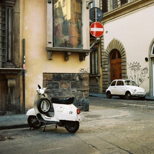 Vespa and Fiat 500: icons of romantic Rome.