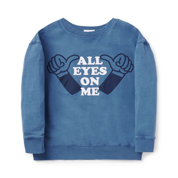 100% Cotton French Terry Sweater. Features 'All Eyes On Me' slogan print on front panel. 2x2 rib trims. Relaxed silhouette with dropped shoulder. Available in Hazy Blue.