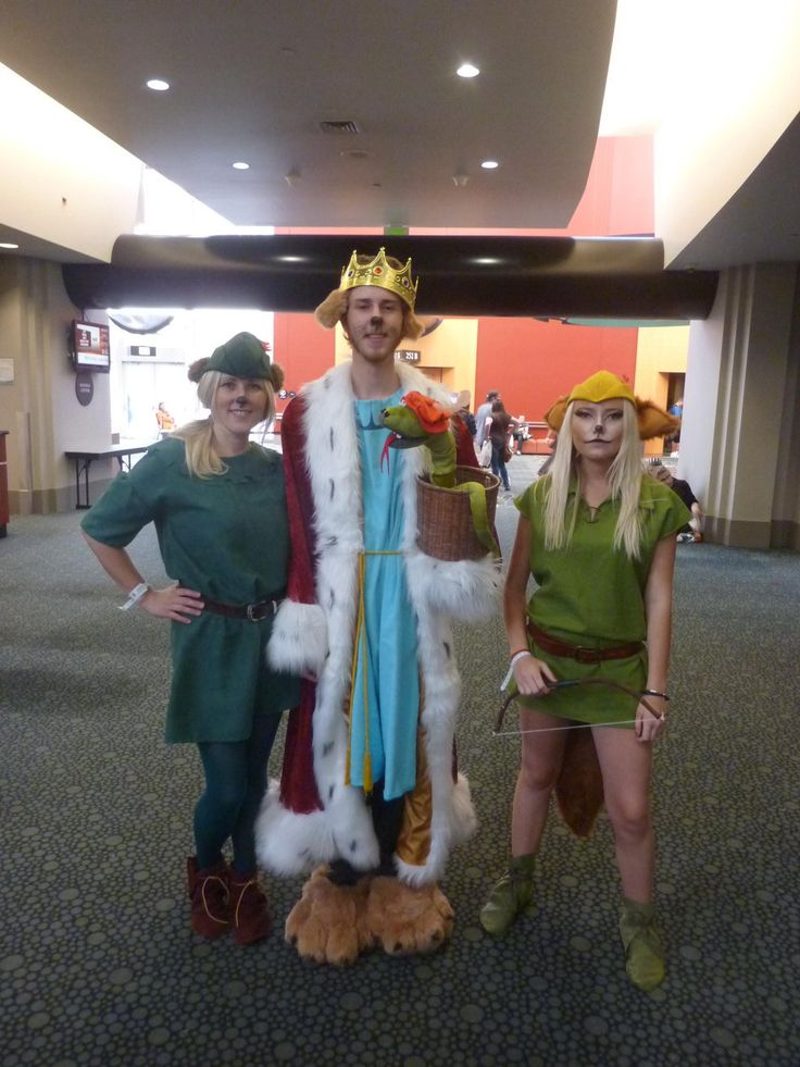 """One of the more unique costume groups from @slcomiccon: Disney Robin Hood, Little John, Prince John w/Sir Hiss. :)"""