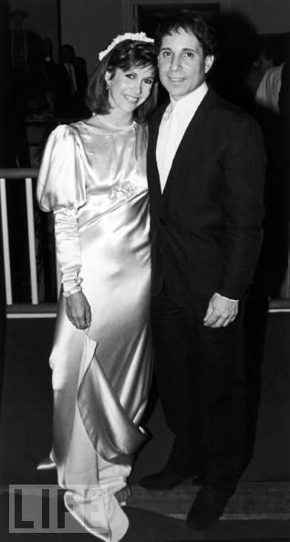 Actress Carrie Fisher with husband, singer Paul Simon, on the evening of their wedding, 1983.