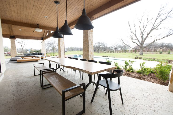 Scandinavian style inspires the design of the large outdoor Living and Dining area, complete with fireplace, bar, and custom outdoor sofa.
