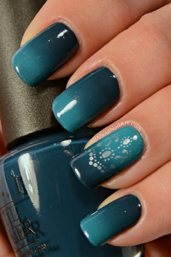 Dark green and blue green Ombre nail art. Step up your Ombre nail art game by adding silver designs on top of your color combination