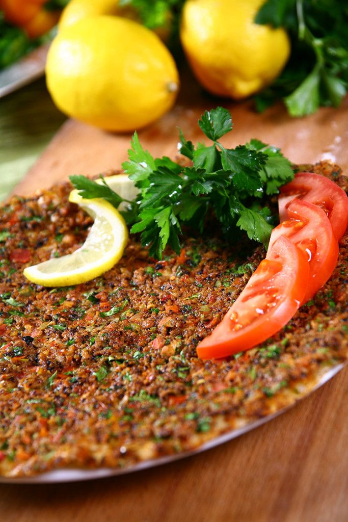 Lahmacun – or Turkish pizza, as some people call it. But this is nothing like pizza, because this dish got that Oriental – Middle Eastern flavor which will bring you back asking for more. It' a combination of a fine Arabian dough and a nicely mixed meat paste.