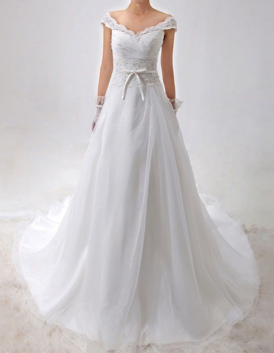 This Embroidered Satin and Organza Wedding Gown with off the shoulder styling and a sweetheart neckline, has a natural waist and a lace-up back, and this gown would be perfect for a stylish Wedding ceremony and reception