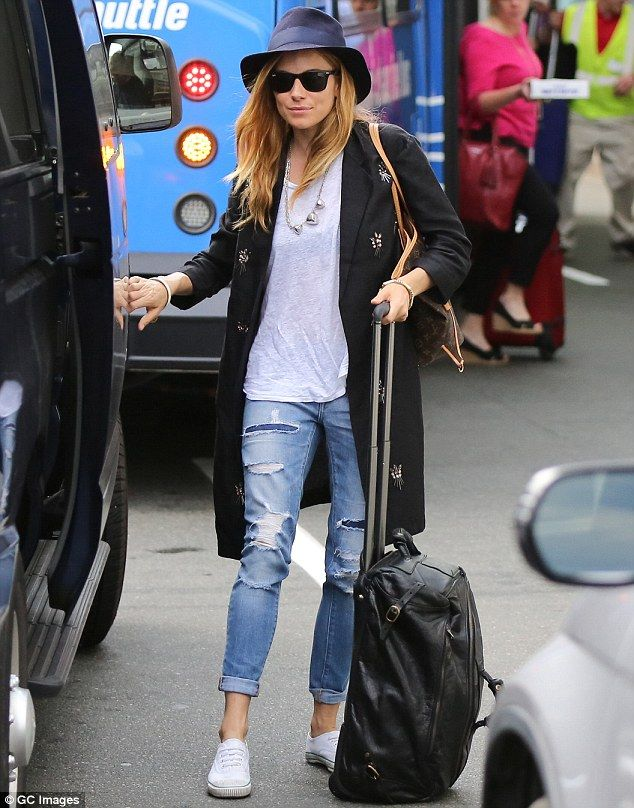She's a cool customer: Sienna Miller was spotted arriving into Boston airport on Tuesday i...