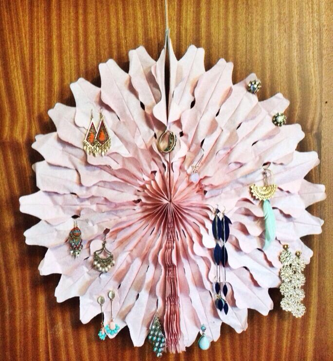 Simple pretty earring display .  Very cheap and looks great in a room