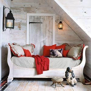 antique daybed nestled into a shallow nook makes the perfect lounging getaway