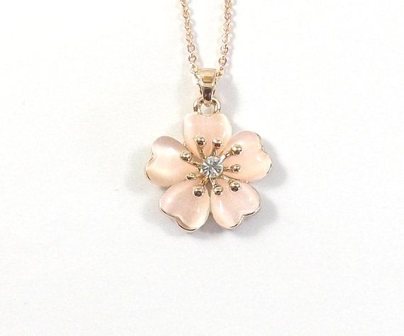 Spring is Cherry Blossom Time! Celebrate Spring with this cat's eye and rose gold cherry blossom necklace.