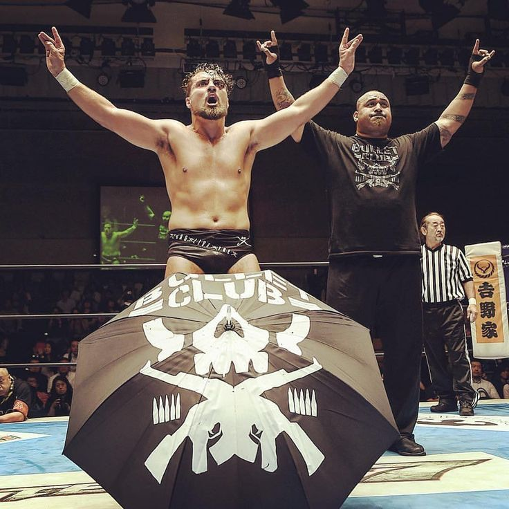 Marty Scurll and Bad Luck Fale.