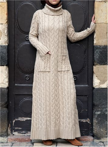 Who says there's such a thing as too much cable knit? We think not, and this luxuriously cozy dress proves it. The cotton fabric works well for that brisk end-of-winter weather as well as spring. The beautiful cable knit design gives the dress a dignified look, while the slouchy turtleneck adds extra coziness.