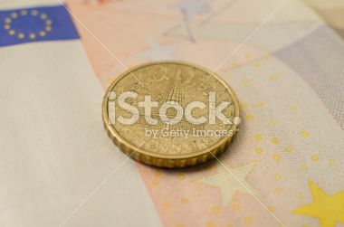 Slovenia Twenty Euro Cent Coin on a Fifty Banknote Royalty Free Stock Photo