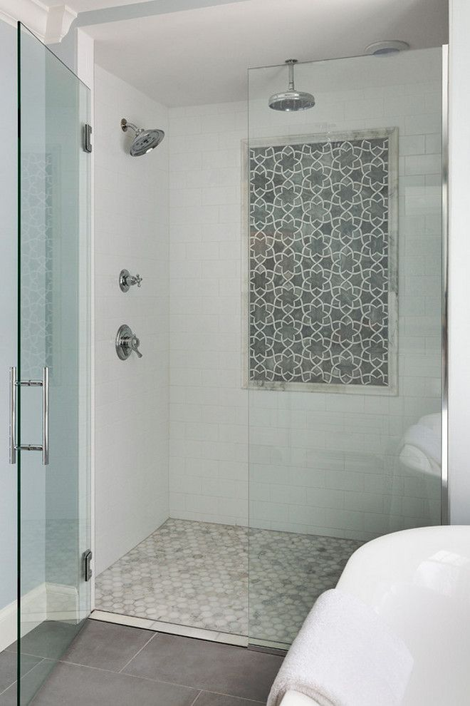 the shower features a classic combination of marble and white subways tiles grace hill design
