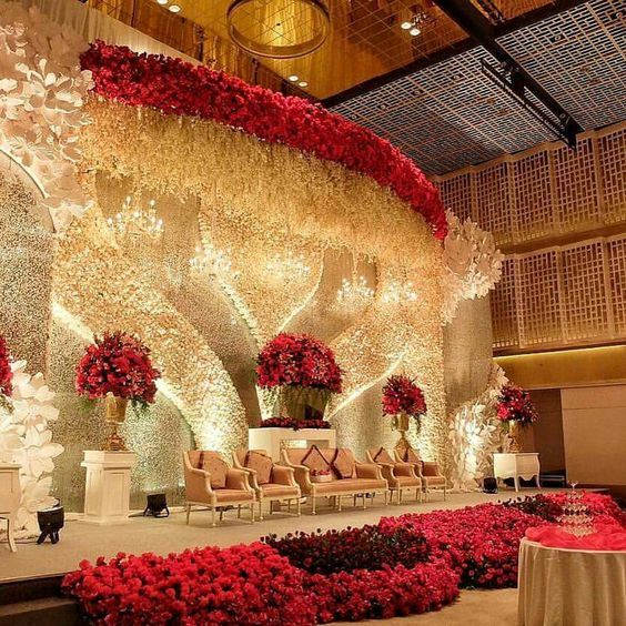 A magical stage, shining bright with lights and looking stunning decked up in red and white florals <3| Curated by Witty Vows – Things No one tells brides |The ultimate guide for the Indian Bride to plan her dream Indian wedding. Real weddings, ideas, trends, recomendations and inspiration | ♥ ♥ ♥ | #bridal #fashion #inspiration #IndianWedding | | www.wittyvows.com